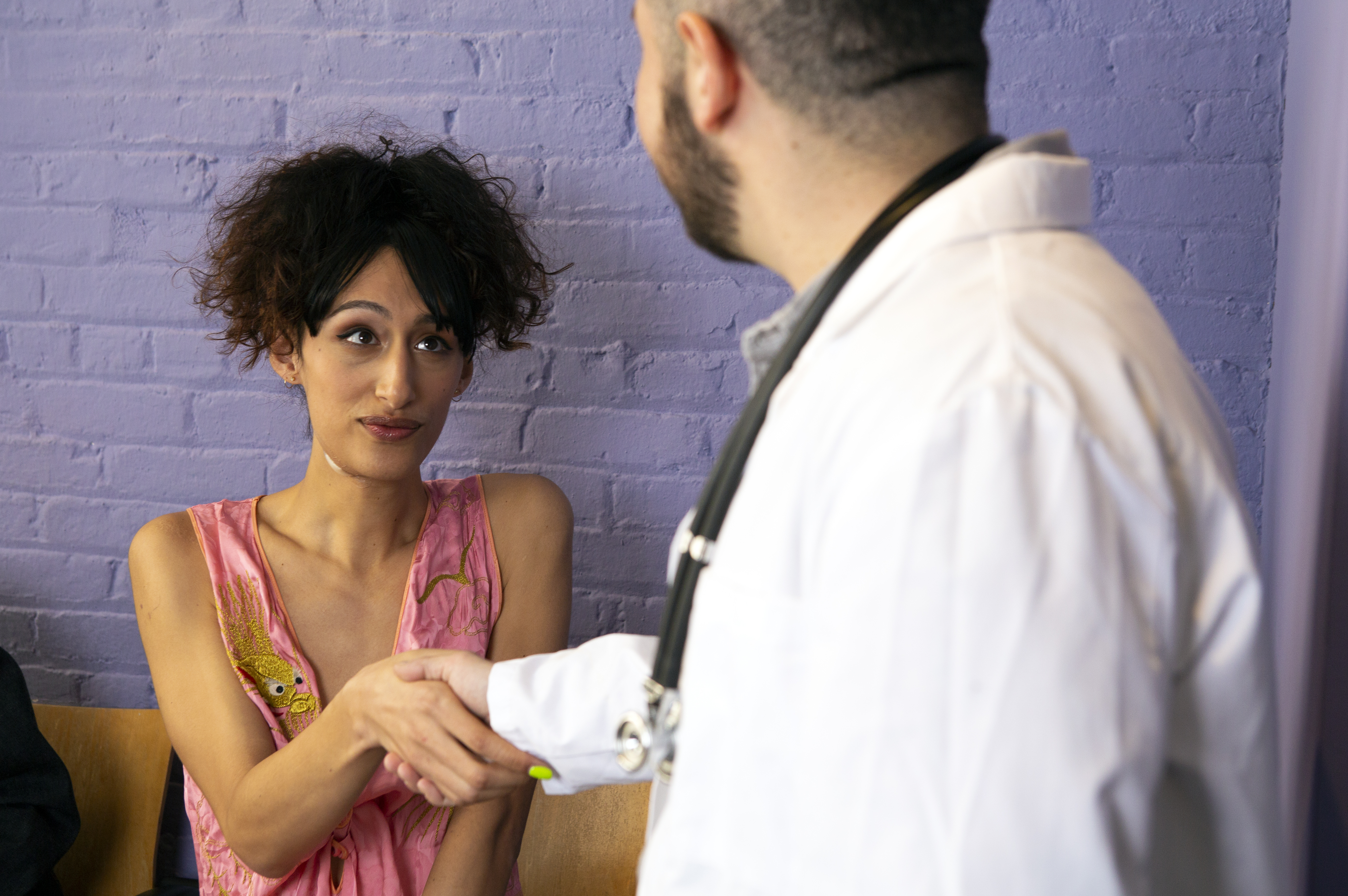 A transgender woman meeting her doctor in the waiting room of  doctor's office