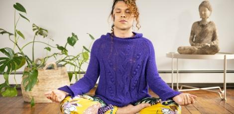 A genderfluid person meditating