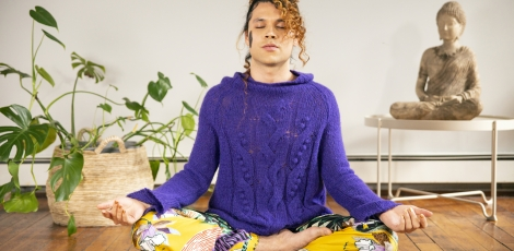A genderfluid person meditating